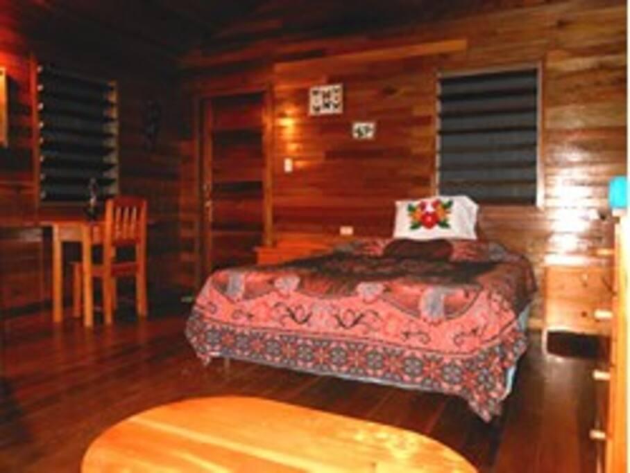 Queen sized bed in Toucan Cabana
