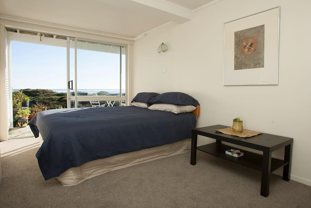 Queen bedroom with sea views