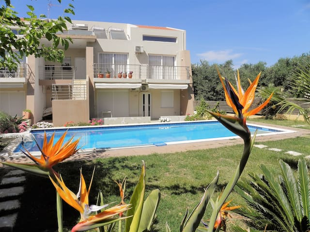 Holiday Apartment with Private Yard & Shared Pool
