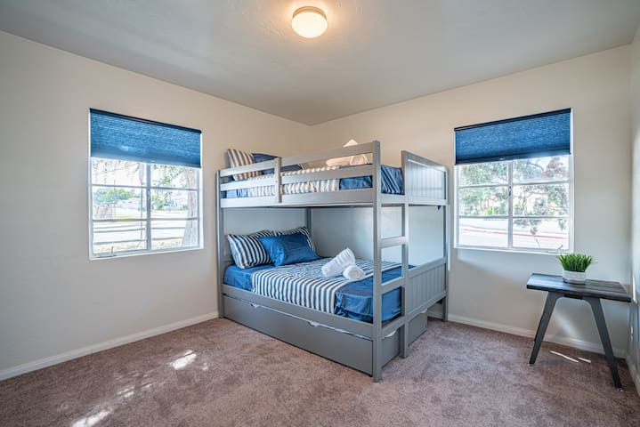 Full size Bunk Beds with a pull out Single for those big travels with bigger memories.