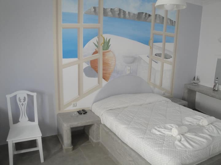 Renovated traditional room in family hotel in Fira