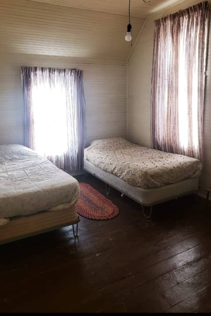Rustic room in shared house, sleeps 2 singles