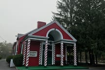 Historic train depot with Christmas themed items for sale.  Very close to the Manse.