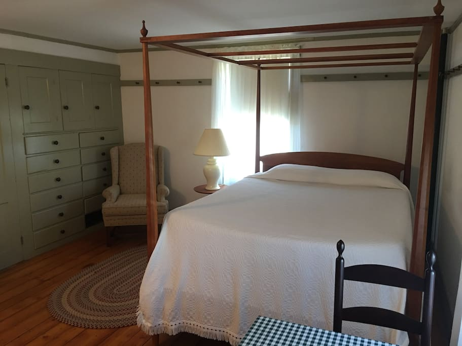 Bedroom features a small sitting table as well as some food amenities.