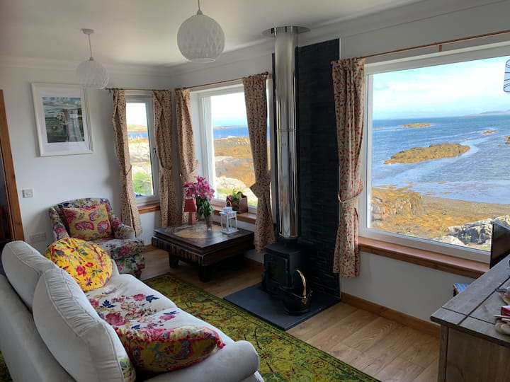 Hebridean cottage on the seashore.