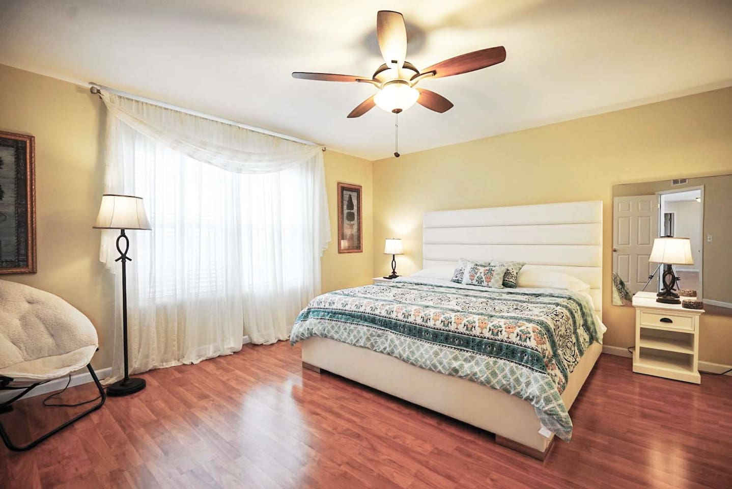Large Master Bedroom furnished for comfort with wall hung TV, large walk-in closet and private master bathroom!