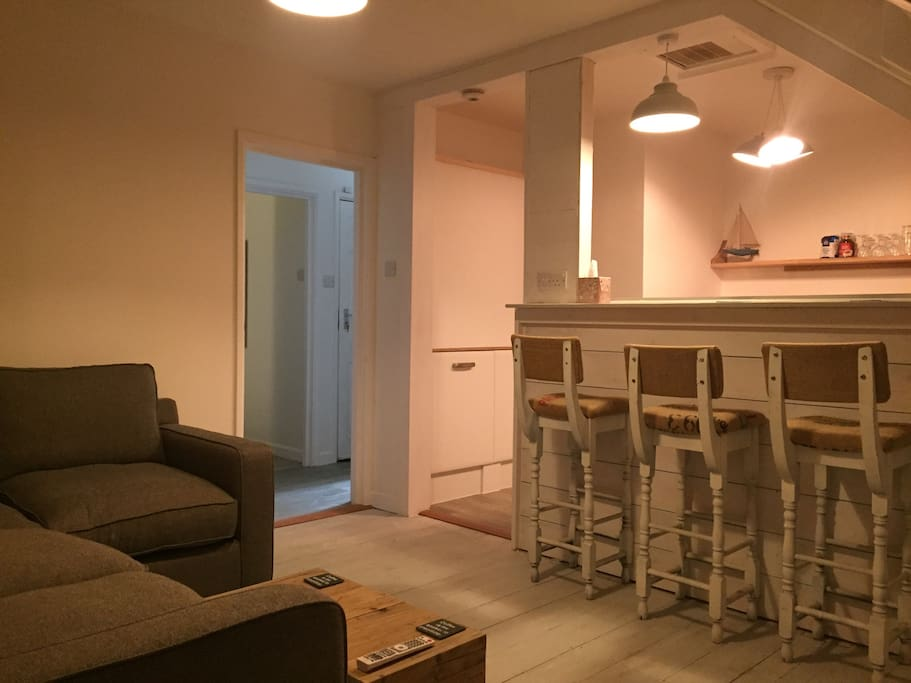 Cosy living room/breakfast bar perfect for evening drinks.