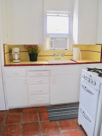 cool retro FULL kitchen with coffee maker, blender, toaster, stove, refrigerator/freezer, microwave