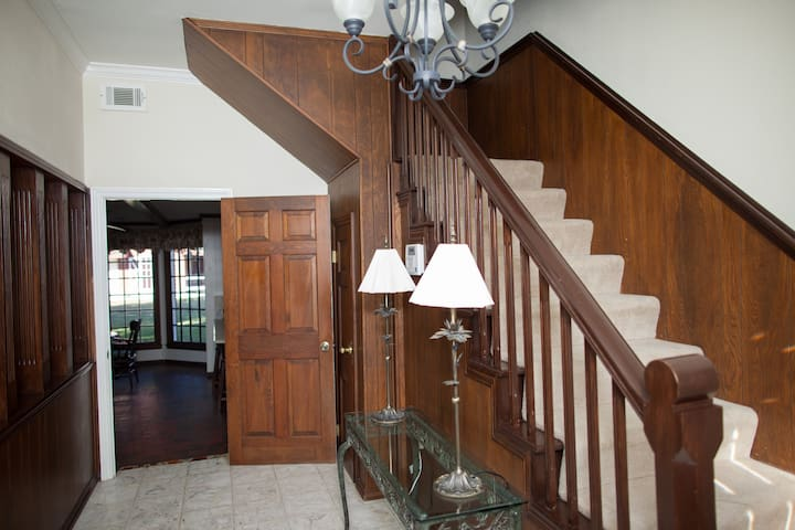 Entry way - formal living on left, game room on right, dining and kitchen straight ahead