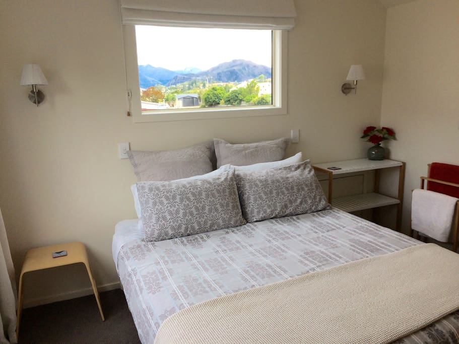 Second queen bedroom, with views of the lake and mountains.
