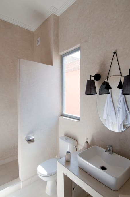 Private bathroom in the Kotubia Room has a shower and window to the street