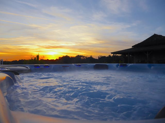 Relax in the hot tub and watch the sun go down
