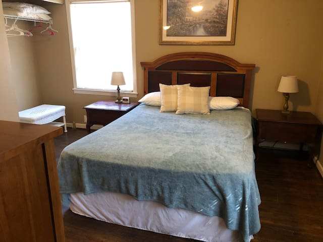 Master BR with ensuite half bath has a queen size bed, end tables, wicker luggage stand and dresser.  Also, has a new light and fan with a remote.