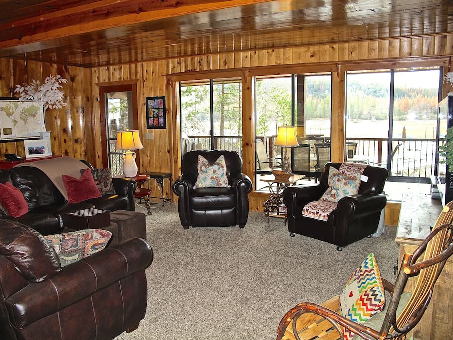 Living Room with doorway to the Covered Deck and walk to your Dock.