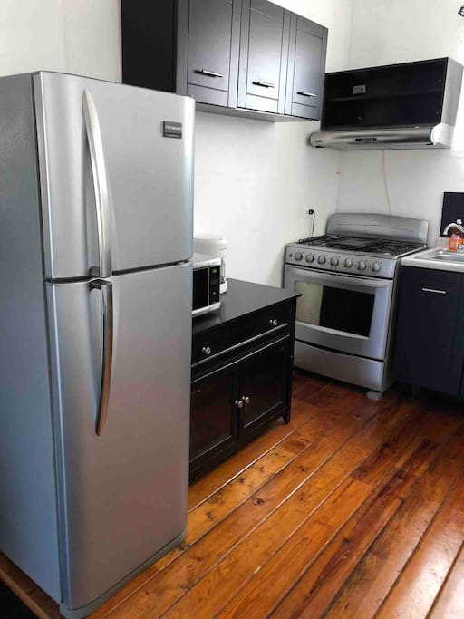 Fully equipped kitchen, with stove , full size refrigerator, microwave, blender