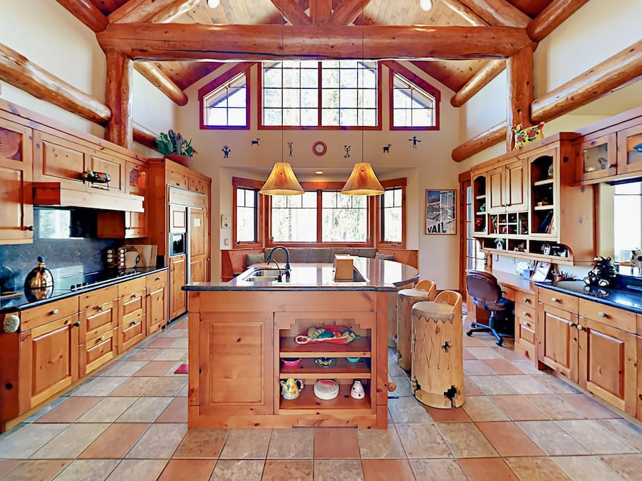 Tons of counter space and large center island in the spacious kitchen.