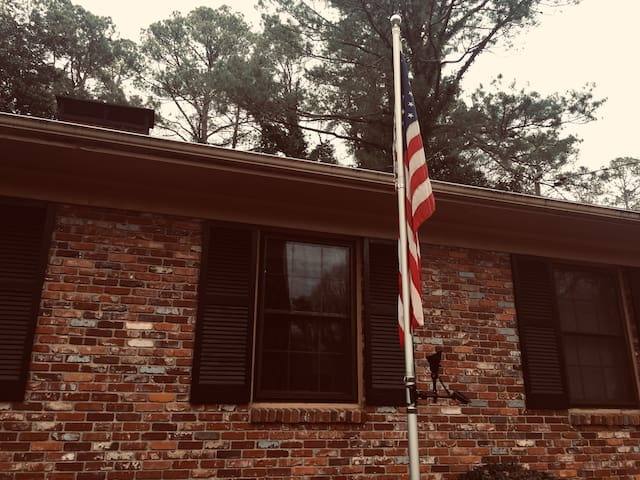 You cannot miss the 25-foot Stars and Stripes. A solar panel illuminates the flag at night.