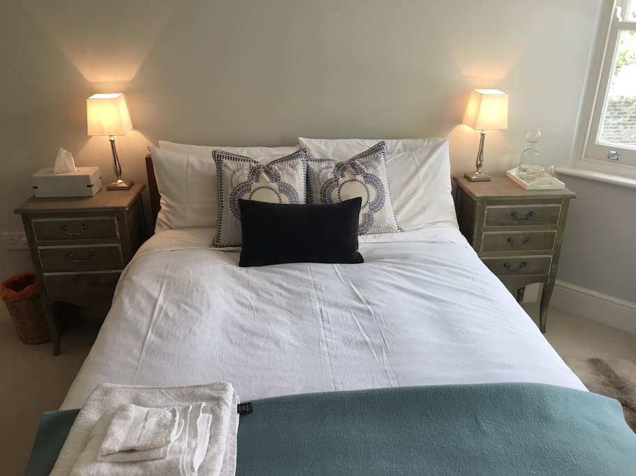 Immaculate room with crisp white sheets, stylish cushions, new carpets and freshly painted walls. The side lamps are touch sensitive too! There are also tissues and a water jug and glasses by the bed. We do our best to make sure you have everything you need.