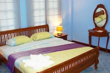 Front bedroom with all teak furniture and reading lamps and TV of course.