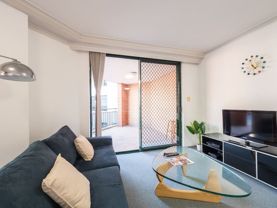 Spacious living area with sofa bed and entertainment unit