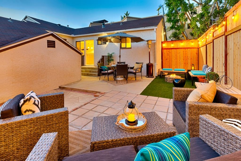 Enjoy this spacious Backyard with ample seating.