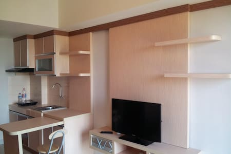 Cozy and Homey 1 Bedroom Apartment at BSD City
