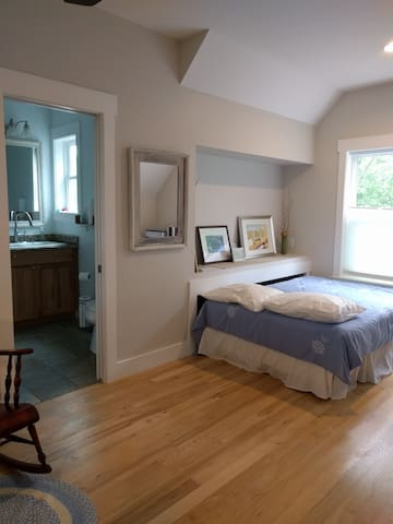 The loft space with queen bed and private full bath is your space.
