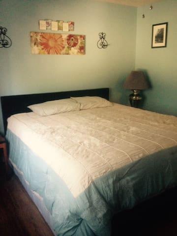 California King bed in bedroom