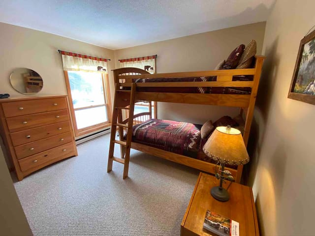 Bunk room 2 twin beds and Rollaway twin in closet