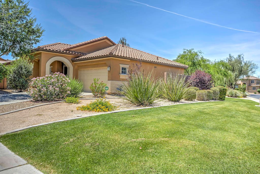 A beautifully landscaped front yard greets you as you arrive at the house.
