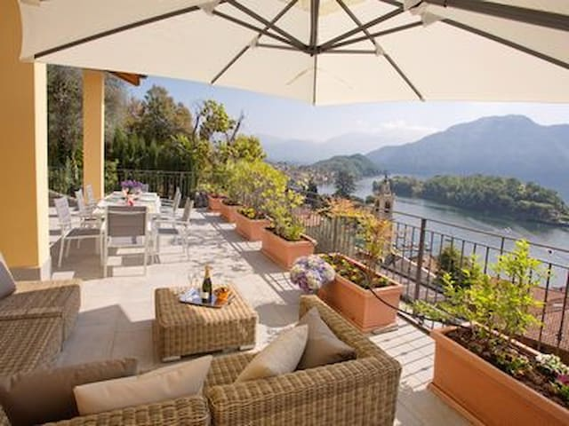 Large private terrace with stunning lake and mountain views