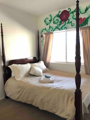Queen poster bed in Rose room, downstairs with private entrance and detached bathroom.