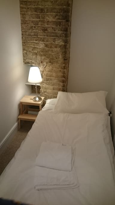 Simple blow up mattress in plain cosy flat in Central London. Central heating