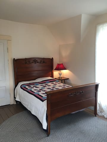 Front Room with double bed and closet.