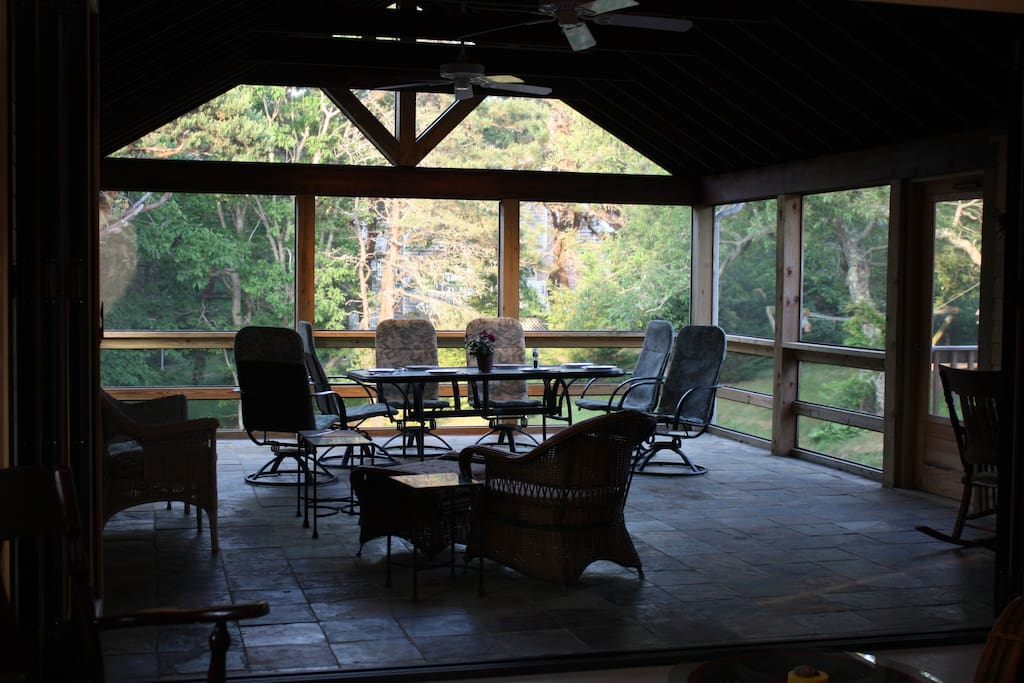 Living room opens onto this huge screened porch