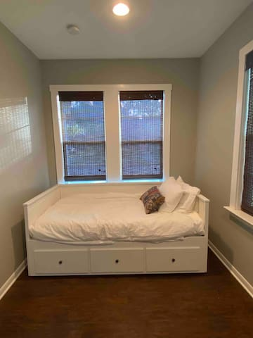 The third bedroom features a twin trundle bed that pulls out to create a king, with new crisp cotton sheets and light duvet comforter. This room also features a desk area for getting a little work done.