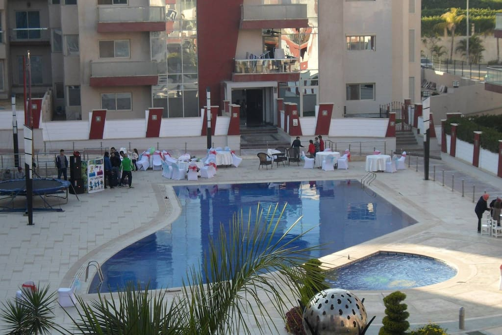 View from balcony with swimming pool and gardens