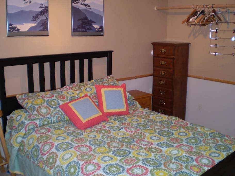 2nd bedroom with full  size bed  and space to hang clothes.