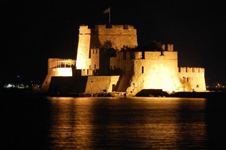 Bourtzi castle into the sea illuminated by night!