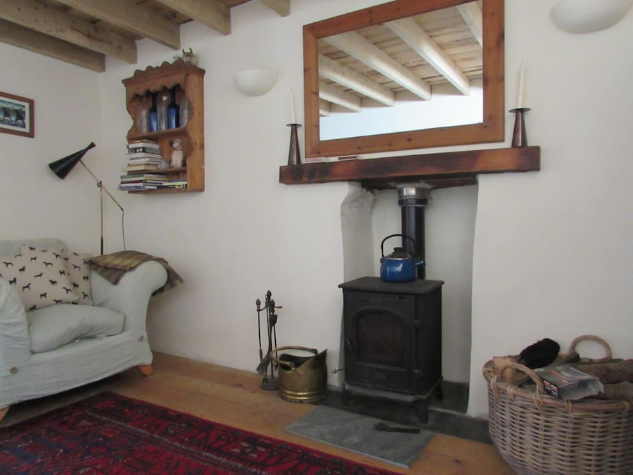 cosy lounge with woodburning stove and complimentary first basket of logs , reading material