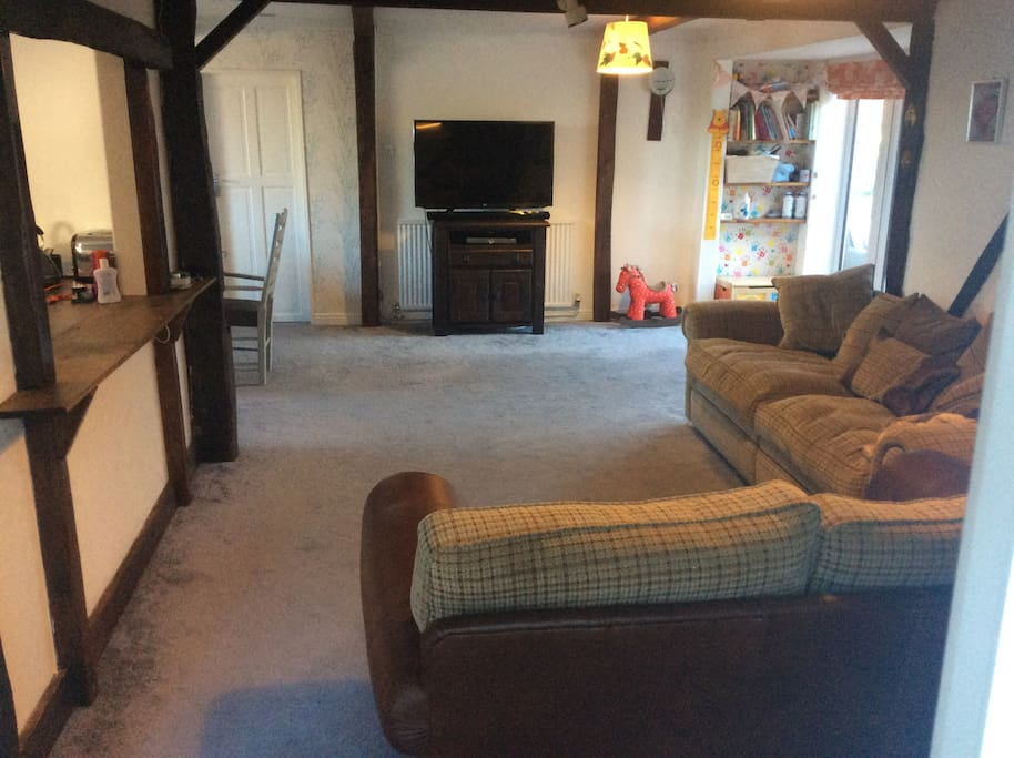 Large open plan living space with beautiful character and modern comforts