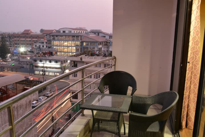 View from the balcony (supermarket & Taxi stand in the background)