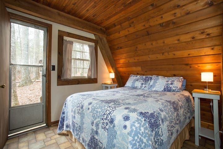 A comfortable queen size bed overlooks beautiful woodlands. Sleep to the sound of a tranquil stream rushing nearby.