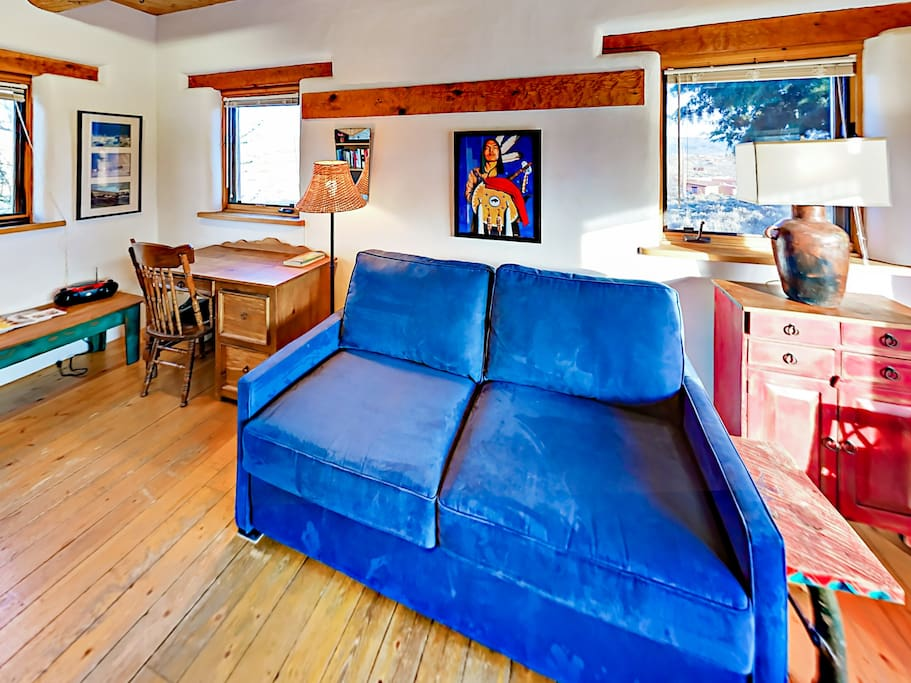This charming adobe includes a convenient office space with a desk, the ultimate writer's retreat!
