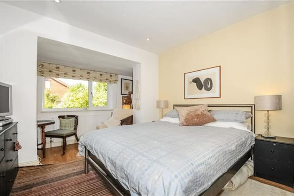 Double bedroom, view over garden private bathroom