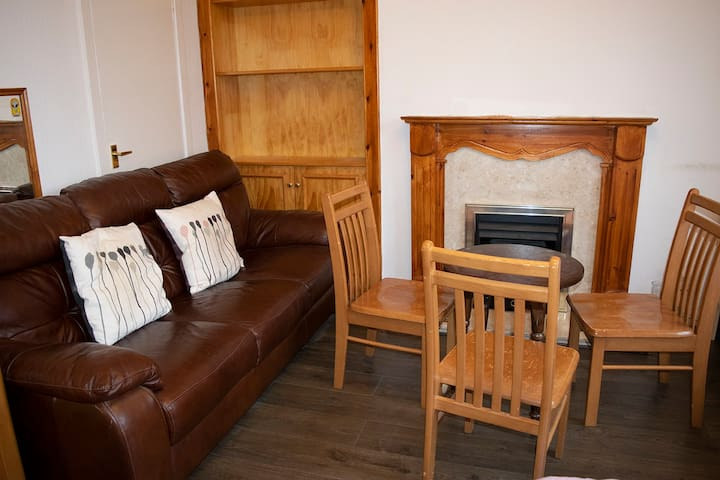 Spacious Double Room with Sofa, Table & Fireplace