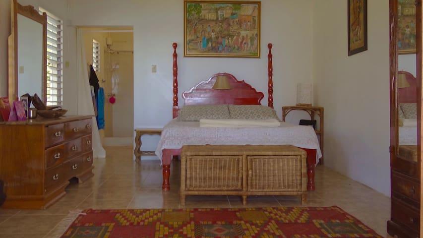 Bedroom suite double doors opens to sea view and onto the    veranda.