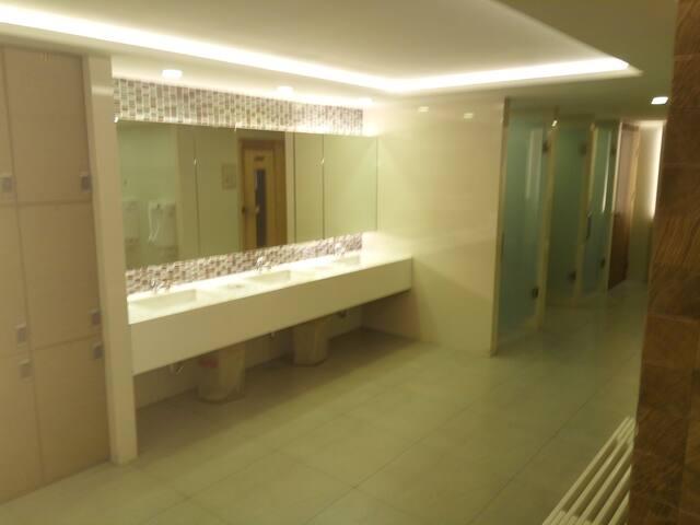 change room ,showers, sauna and steam room