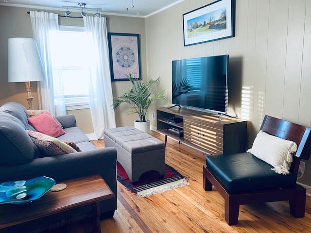 """The Rosedale Retreat (UP) Offers a comfy living room with a plush couch and 60"""" RokuVision TV featuring Netflix, Hulu and Disney Plus. Need sports? We've got you guys covered with ESPN+ so you don't have to miss a moment of the big game!"""