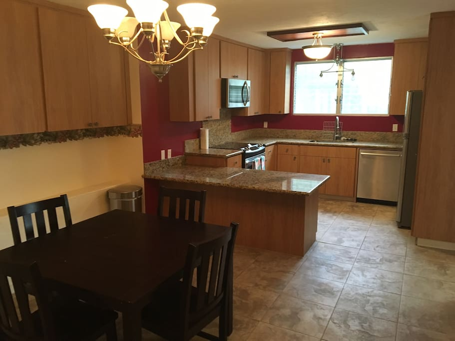 Large dining room and kitchen with premium appliances